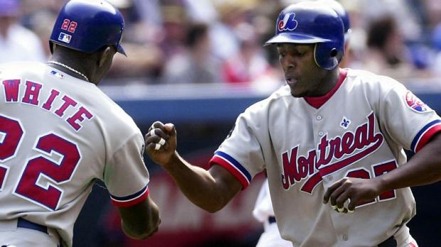 Montreal Expos Rondell White (left) congratulates