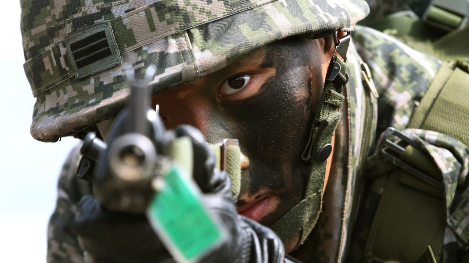 A South Korean marine aims his machine gun during the U.S.-South Korea joint landing exercises called Ssangyong, part of the Foal Eagle military exercises, in Pohang, South Korea, Monday, March 31, 2014. (AP / Ahn Young-joon)