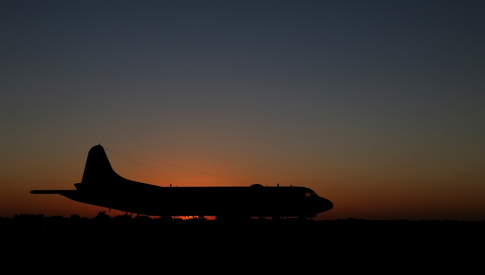 A Japan Maritime Self-Defense Force P-3C Orion sits on the tarmac at Royal Australian Air Force Base Pearce in Perth, Australia, Tuesday, April 1, 2014. (AP / Rob Griffith)