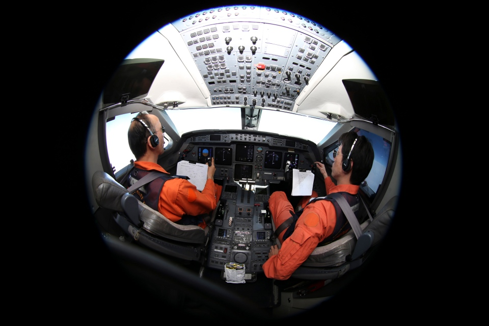 Captain of the Japan Coast Guard Gulfstream Makoto Hoshi left, and his co-pilot Shunichi Yumiza sit in the cockpit during a search for the missing Malaysia Airlines Flight MH370 in Southern Indian Ocean, near Australia, Tuesday, April 1, 2014. (AP / Rob Griffith)