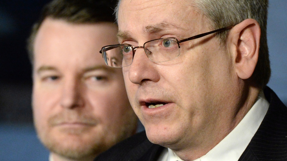 NDP MPs Charlie Angus, right, and Mathieu Ravignat hold a press conference in the foyer of the House of Commons on Parliament Hill in Ottawa on Tuesday, April 1, 2014. (Sean Kilpatrick / THE CANADIAN PRESS)