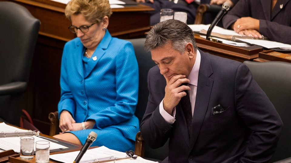 Ontario Premier Kathleen Wynne (left) sits with Finance Minister Charles Sousa during question period at Queen's Park in Toronto on Tuesday, April 1, 2014. (Chris Young / THE CANADIAN PRESS)