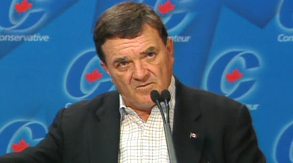 Finance Minister Jim Flaherty speaks to reporters from the Conservative caucus meeting in Levis, Que. on Wednesday, July 30, 2008.
