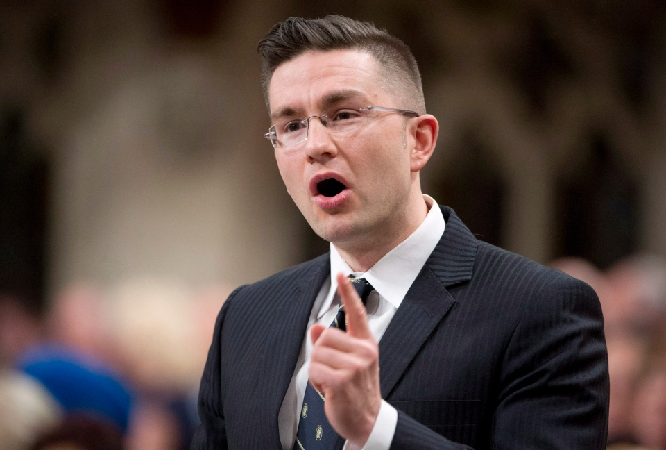 Minister of State (Democratic Reform) Pierre Poilievre responds to a question in the House of Commons on Monday March 24, 2014 in Ottawa. (Adrian Wyld / THE CANADIAN PRESS)