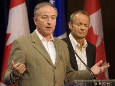 Justice Minister Rob Nicholson, left, responds to questions during a media availability as Public Safety Minister Stockwell Day listens, at the Conservative caucus meeting, in Levis, Que. on Wednesday July 30, 2008.  (Clement Allard / THE CANADIAN PRESS)