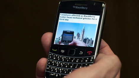 A BlackBerry user tests out his smartphone