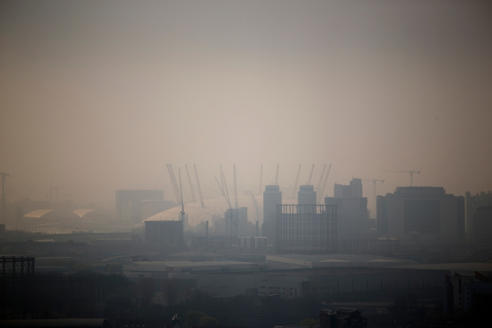 The Millennium Dome is shrouded in smog in London, as seen from a viewing gallery in the Orbit sculpture during a tour organized for the media, Wednesday, April 2, 2014. (AP / Matt Dunham)