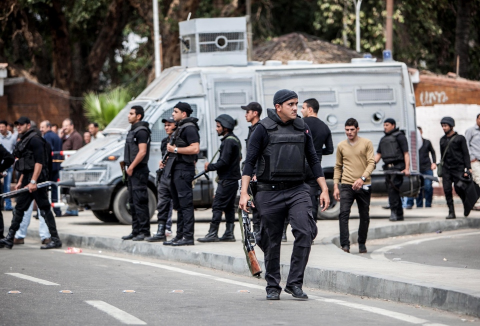Egyptian security forces stand guard at the scene after multiple explosions hit the area outside the main campus of Cairo University, killing at least two, in Giza, Egypt, Wednesday, April 2, 2014. (AP / Amru Taha)