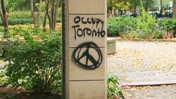 'Occupy Toronto' is spray-painted on cement one day before the 'occupy' movement arrives in the city on Friday, Oct. 14, 2011.