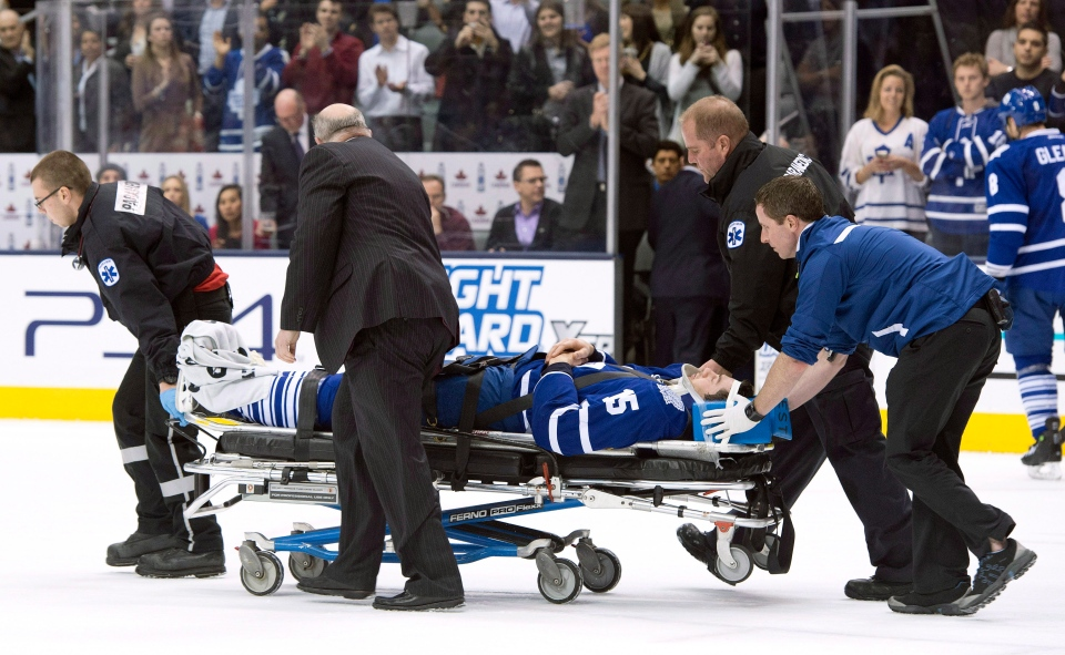 Toronto Maple Leafs' Paul Ranger is taken off the ice on a stretcher after hitting the boards head first from a check by Tampa Bay Lightning's Alex Killorn during first period NHL action in Toronto on Wednesday March 19, 2014. THE CANADIAN PRESS/Frank Gunn