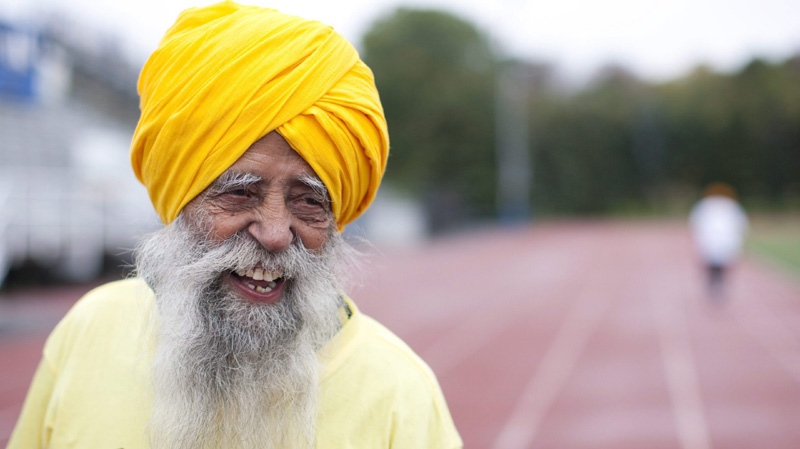 FILE - Centenarian Fauja Singh is pictured on the track between races in Toronto Thursday 13 October 11, 2011.