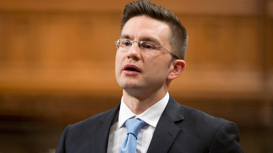 Minister of State (Democratic Reform) Pierre Poilievre responds to a question during question period in the House of Commons, in Ottawa, Wednesday, April 2, 2014. (Adrian Wyld / THE CANADIAN PRESS)