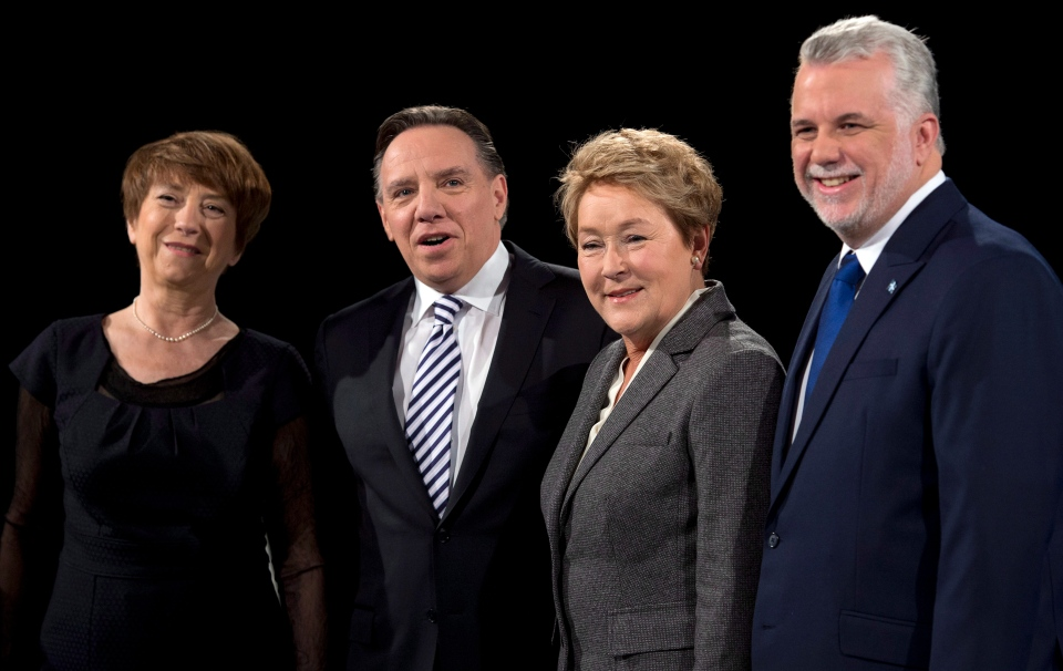 From left, Quebec Solidaire Leader Francoise David, Coalition Avenir du Quebec Leader Francois Legault, Parti Quebecois Leader Pauline Marois, and Liberal Leader Philippe Couillard pose for photos before the first debate of the election campaign, in Montreal, Thursday, March 20, 2014. (Ryan Remiorz / THE CANADIAN PRESS)