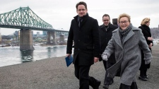 PQ Leader Pauline Marois leaves a rooftop news con