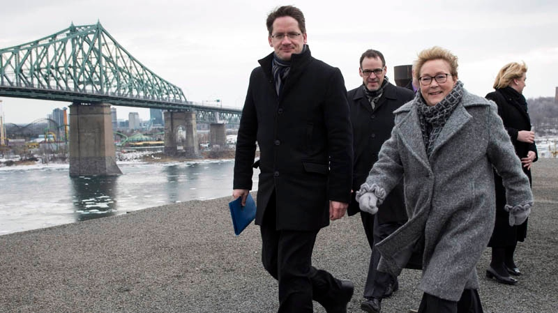 PQ Leader Pauline Marois leaves a rooftop news conference with candidate Sylvain Gaudreault Wednesday, April 2, 2014 in Montreal. THE CANADIAN PRESS/Paul Chiasson