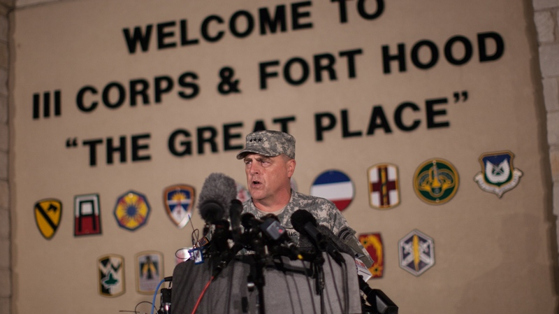 Lt. Gen. Mark Milley, commanding general of III Corps and Fort Hood, speaks with the media outside of an entrance to the Fort Hood military base in Texas on Wednesday, April 2, 2014. (AP / Tamir Kalifa)