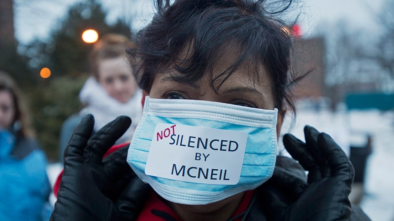 A striking nurse adjusts her face mask outside the Halifax Infirmary in Halifax on Thursday, April 3, 2014. (Andrew Vaughan / THE CANADIAN PRESS)