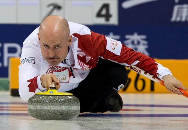 Kevin Koe advances at world championships