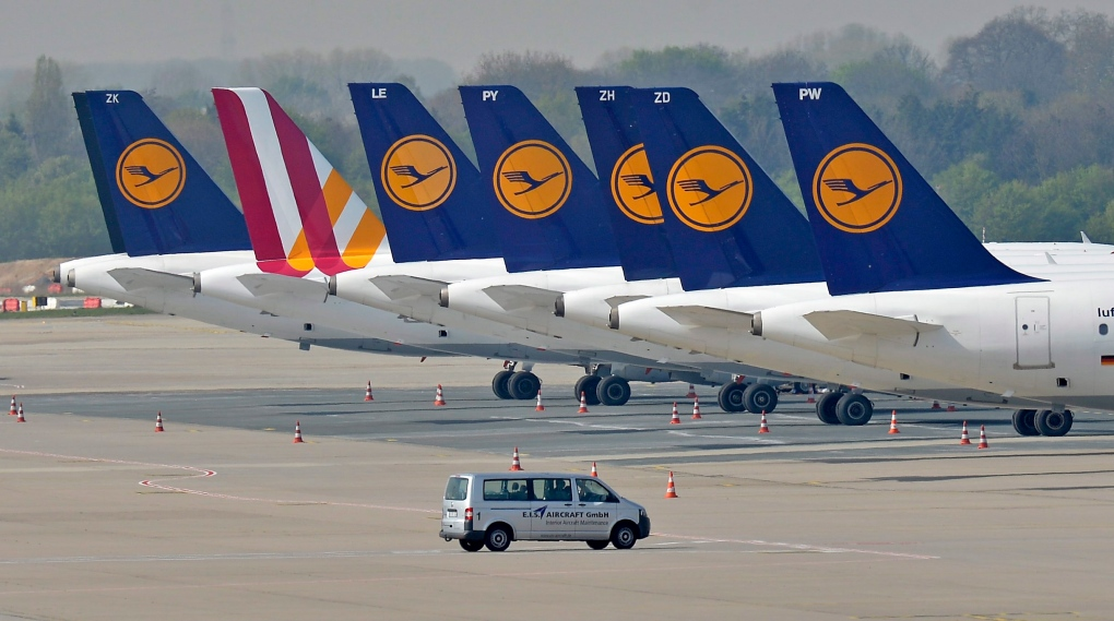 Lufthansa jets park at the airport