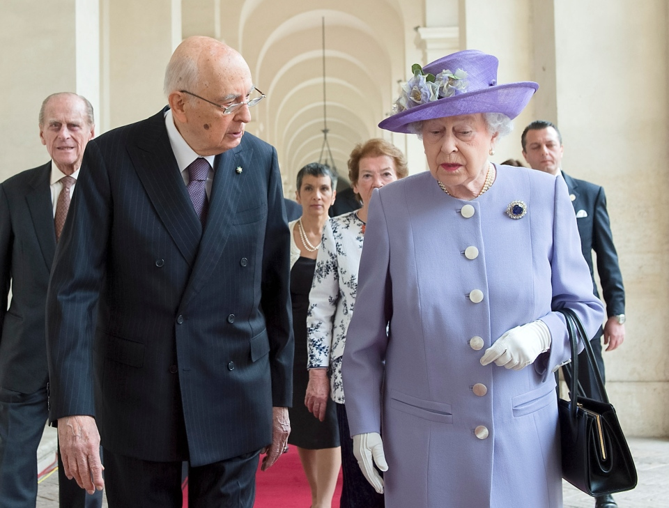 Italian President Giorgio Napolitano, left, talks with Queen Elizabeth II upon her arrival at Rome's Quirinale Presidential Palace, Thursday, April 3, 2014. (Italian Presidency Press Office)