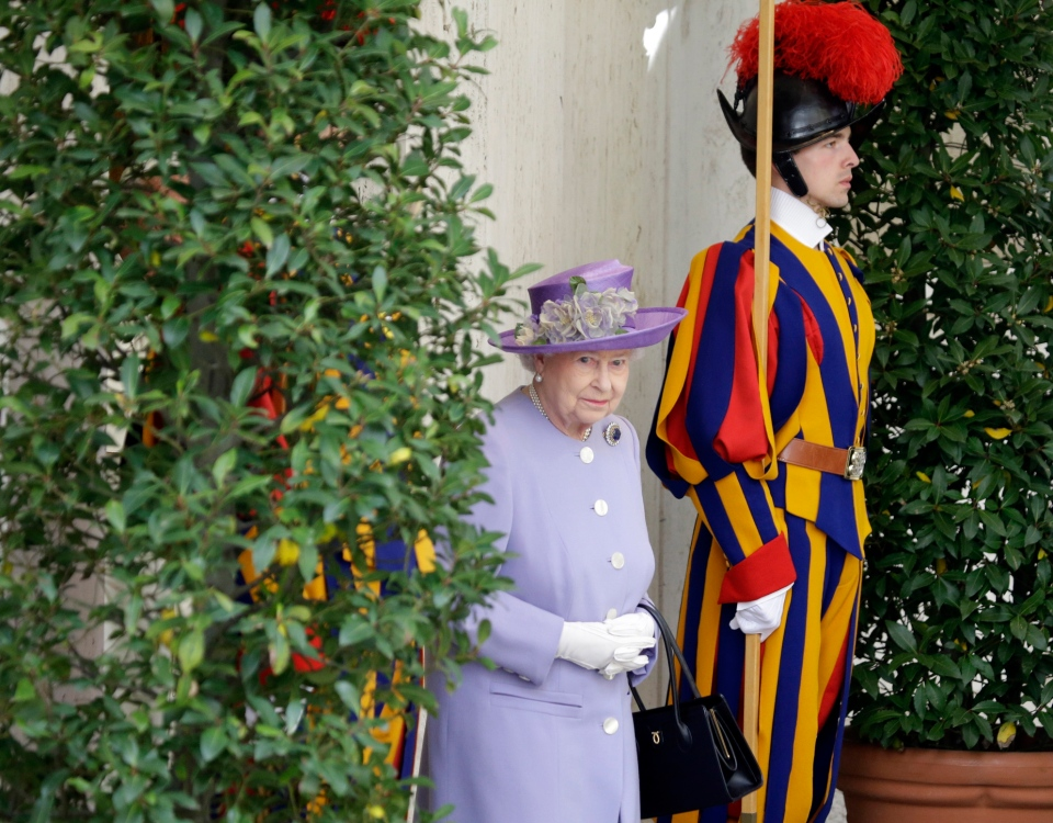 Queen Elizabeth II walks past a Swiss guard after her audience with Pope Francis at the Vatican, Thursday, April 3, 2014. (AP / Gregorio Borgia)