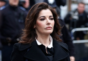 British chef Nigella Lawson arrives at Isleworth Crown Court in London, Wednesday, Dec. 4, 2013. (AP / Sang Tan)
