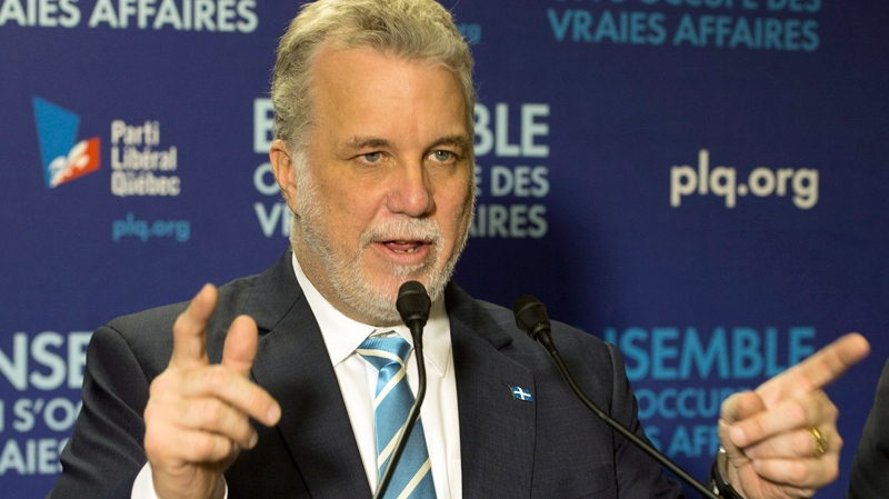 Quebec Liberal leader Philippe Couillard speaks to supporters at the local riding office Thursday, April 3, 2014 while campaigning in Granby, Que. (THE CANADIAN PRESS/Ryan Remiorz)