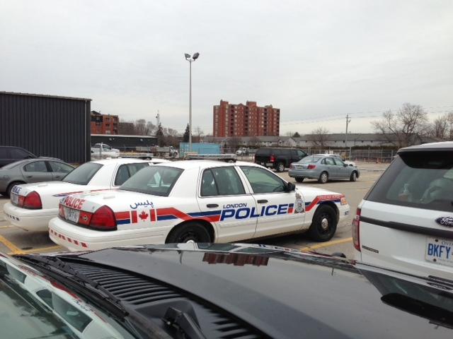 London police cruisers are parked near the building where a wanted woman was barricaded in London, Ont. on Thursday, April 3, 2014. (Nick Paparella / CTV London)