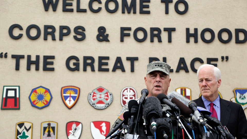 Lt. Gen. Mark Milley, left, and U.S. Sen. John Cornyn, right, talk to the media near Fort Hood's main gate, in Fort Hood, Texas, Thursday, April 3, 2014. (AP / Eric Gay)