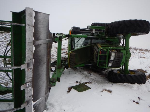 John Deere tractor overturns