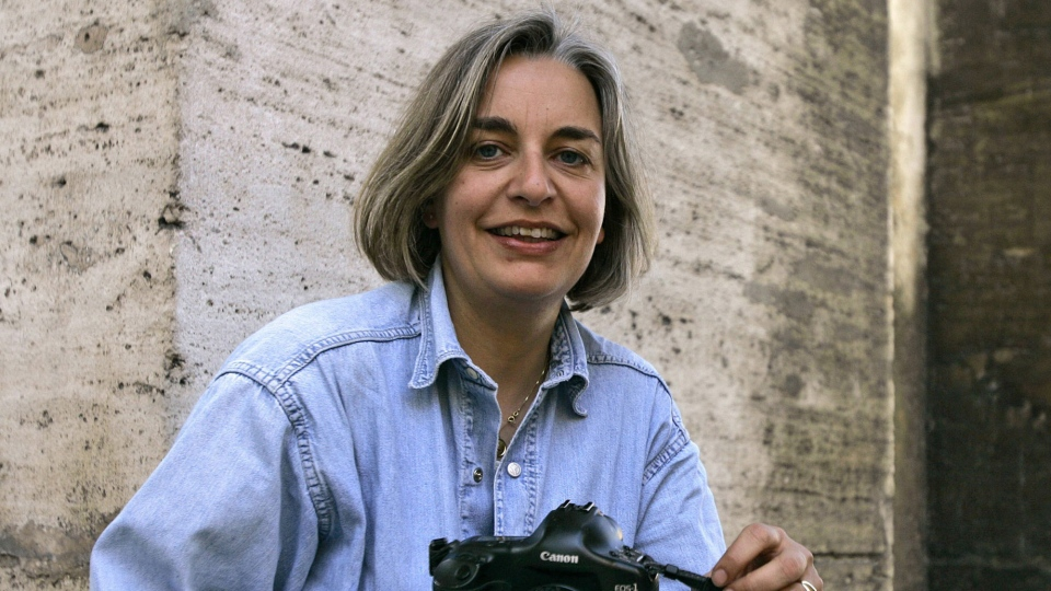 Associated Press photographer Anja Niedringhaus poses for a photograph in Rome, Thursday, April 2005. Niedringhaus, 48, was killed and an AP reporter was wounded on Friday, April 4, 2014 when an Afghan policeman opened fire while they were sitting in their car in eastern Afghanistan.  (AP / Peter Dejong)