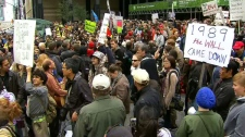 Hundreds of demonstrators gather in Toronto for the Occupy Toronto movement on Saturday, Oct. 15, 2011.