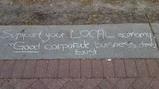 One of several messages written on the sidewalk at the park on Jasper Ave. and 102 St. where dozens have set up camp on Saturday, October 15.