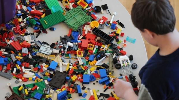 Corbin Belin plays with LEGO