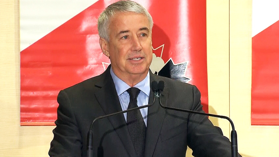 Hockey Canada president and CEO Bob Nicholson announces he is stepping down at a news conference in Toronto, Friday, April 4, 2014.