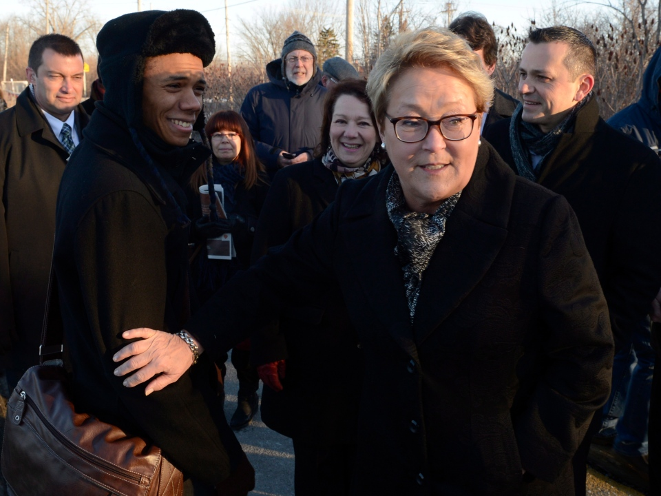 Parti Quebecois leader Pauline Marois greets commuters during a campaign stop at train station in Laval, Que., on Friday, April 4, 2014. (Ryan Remiorz / THE CANADIAN PRESS)