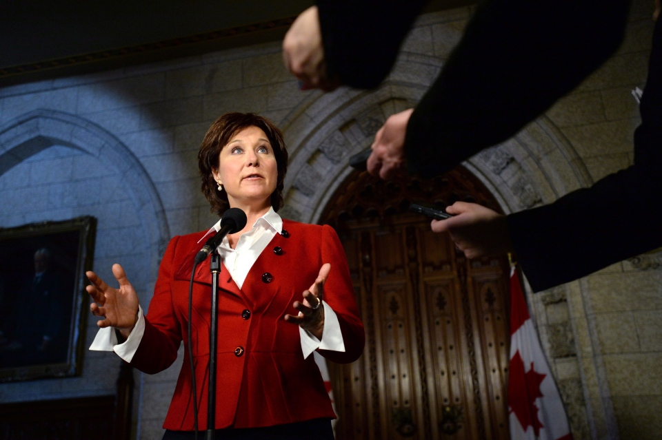 B.C. Premier Christy Clark speaks to reporters in the Foyer of the House of Commons on Parliament Hill in Ottawa on Monday, March 31, 2014. (Sean Kilpatrick / THE CANADIAN PRESS)