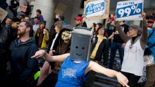 Protestors dance outside the Vancouver Art Gallery during the Occupy Vancouver group assembly in Vancouver, Saturday, Oct. 15, 2011. (Geoff Howe / THE CANADIAN PRESS)