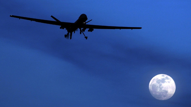 An unmanned U.S. Predator drone flies over Kandahar Air Field, southern Afghanistan, on a moon-lit night, Jan. 31, 2010. (AP / Kirsty Wigglesworth)
