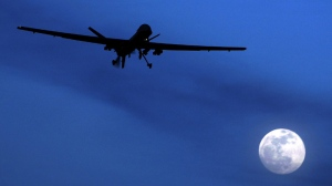 An unmanned U.S. Predator drone flies over Kandahar Air Field, southern Afghanistan, on a moon-lit night, Jan. 31, 2010. (Kirsty Wigglesworth/AP)