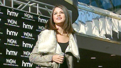 Selena Gomez speaks to fans gathered for a chance to meet the 19-year-old singer and actress at West Edmonton Mall on Sunday, October 16.