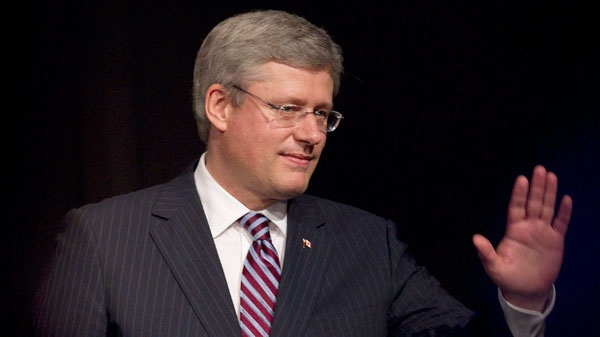 Prime Minister Stephen Harper acknowledges applause after delivering remarks to the Ukrainian Canadian Congress dinner in Toronto, Friday, Oct. 14, 2011. (Chris Young / THE CANADIAN PRESS)