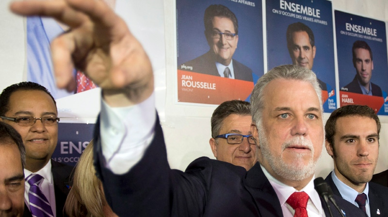 Quebec Liberal leader Philippe Couillard speaks to supporters while campaigning at the local riding office Friday, April 4, 2014 in Laval, Que. Quebecers will vote in a provincial election April 7, 2014. THE CANADIAN PRESS/Ryan Remiorz