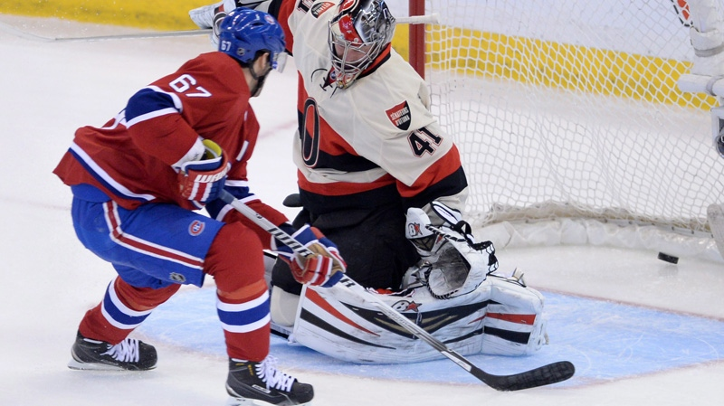 Montreal Canadiens forward Max Pacioretty puts the puck past Ottawa Senators goalie Craig Anderson during first period NHL hockey action in Ottawa on Friday, April 3, 2014. THE CANADIAN PRESS/Sean Kilpatrick