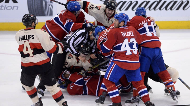 The Ottawa Senators and Montreal Canadiens fight during second period NHL hockey action in Ottawa on Friday, April 3, 2014. THE CANADIAN PRESS/Sean Kilpatrick