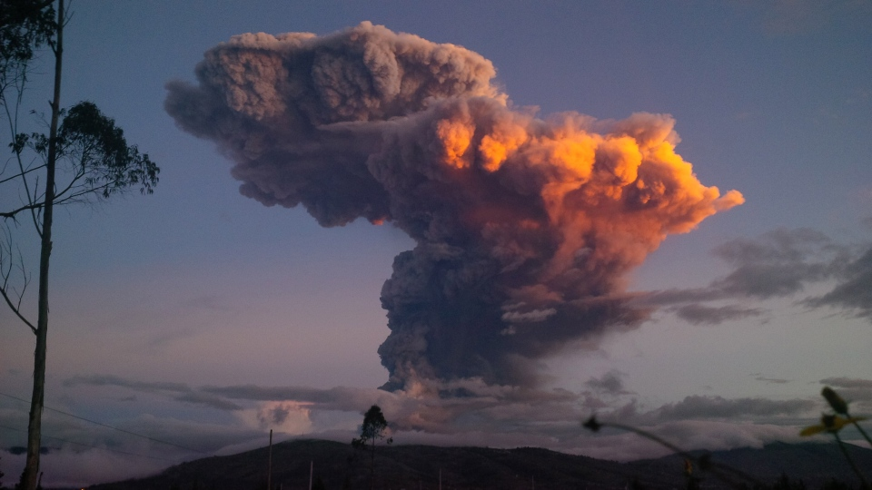 The Tungurahua volcano spews a column of ash as seen from Ambato, Ecuador, Friday, April 4, 2014. (AP)