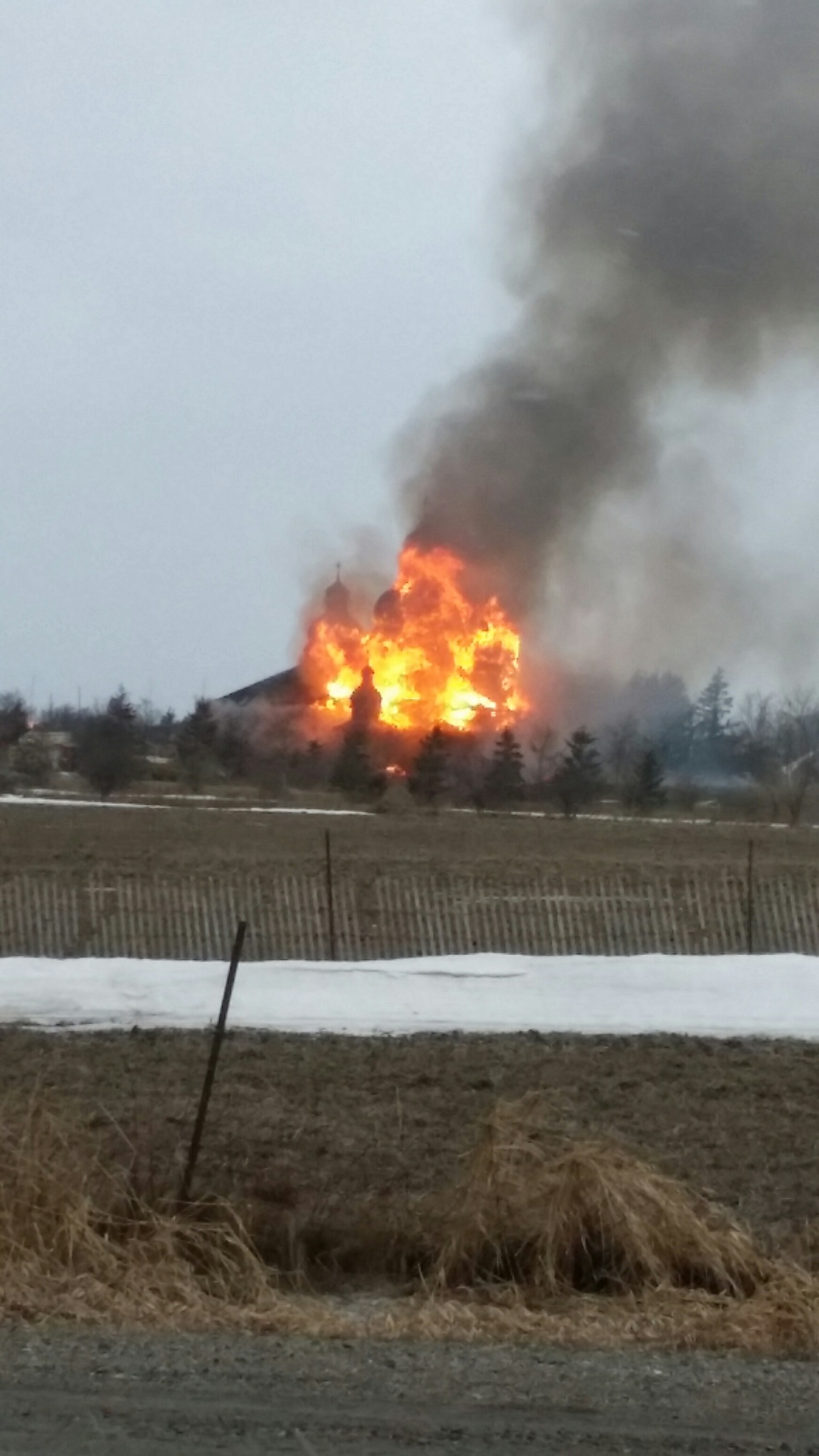 Smoke is seen billowing from a church in Brampton early Saturday morning. Crews are currently battling a two-alarm blaze at the building.(Submitted)
