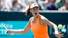 Andrea Petkovic, of Germany, returns to Eugenie Bo