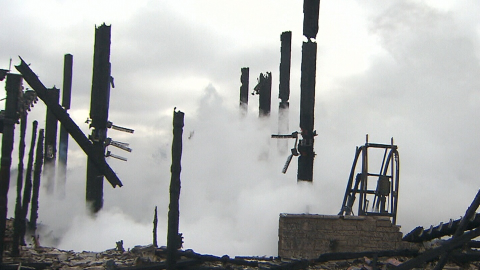 Charred posts still stand following a massive fire at a popular Brampton, Ont. church on Saturday, April 5, 2014.