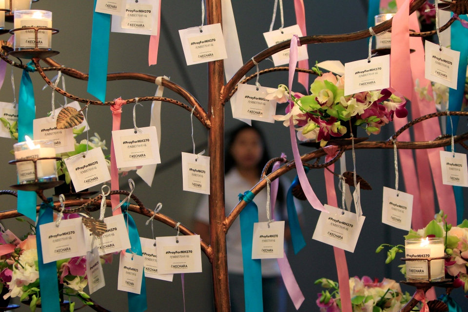 Well-wishes cards for passengers aboard the missing Malaysia Airlines Flight MH370 are tied during a mass prayer for the plane, in Kuala Lumpur, Malaysia, Sunday, April 6, 2014. (AP/Lai Seng Sin)